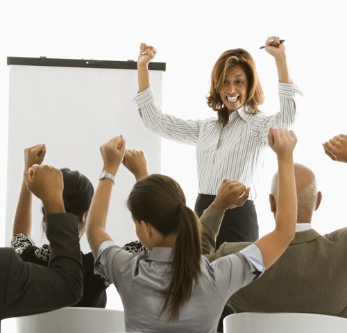 Excited businesswoman with chart giving presentation